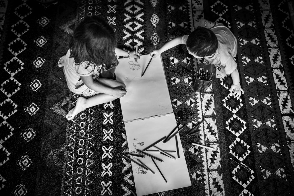 Kids playing on the carpet floor