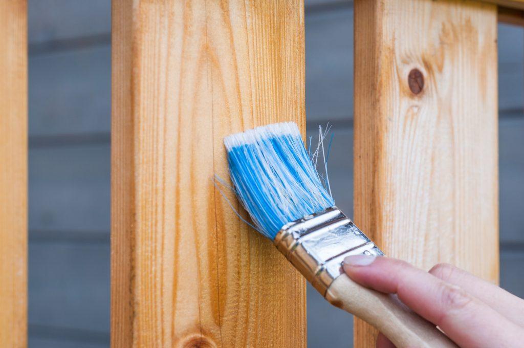 Varnishing wooden deck using brash