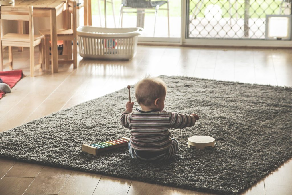 A kid playing on the floor