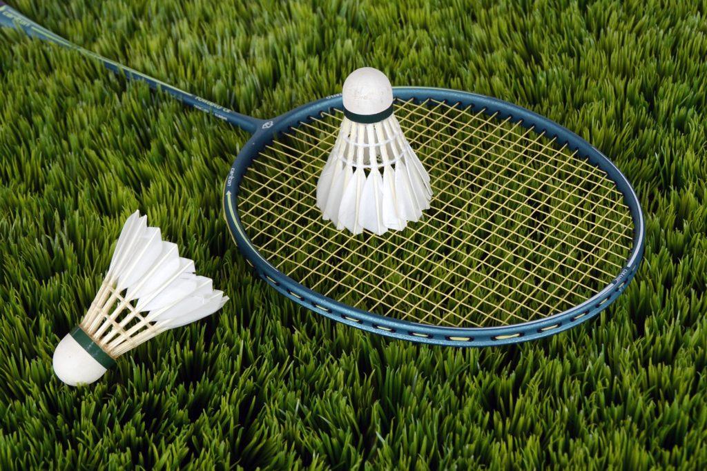 Badminton racket and two shuttlecocks