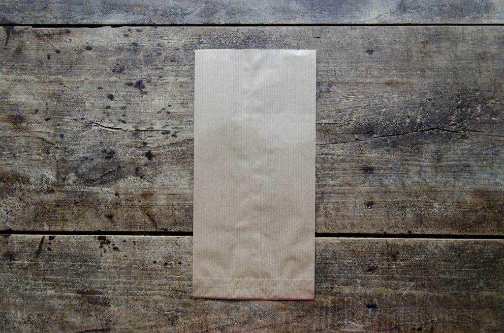 Paper bag placed on a the floor.