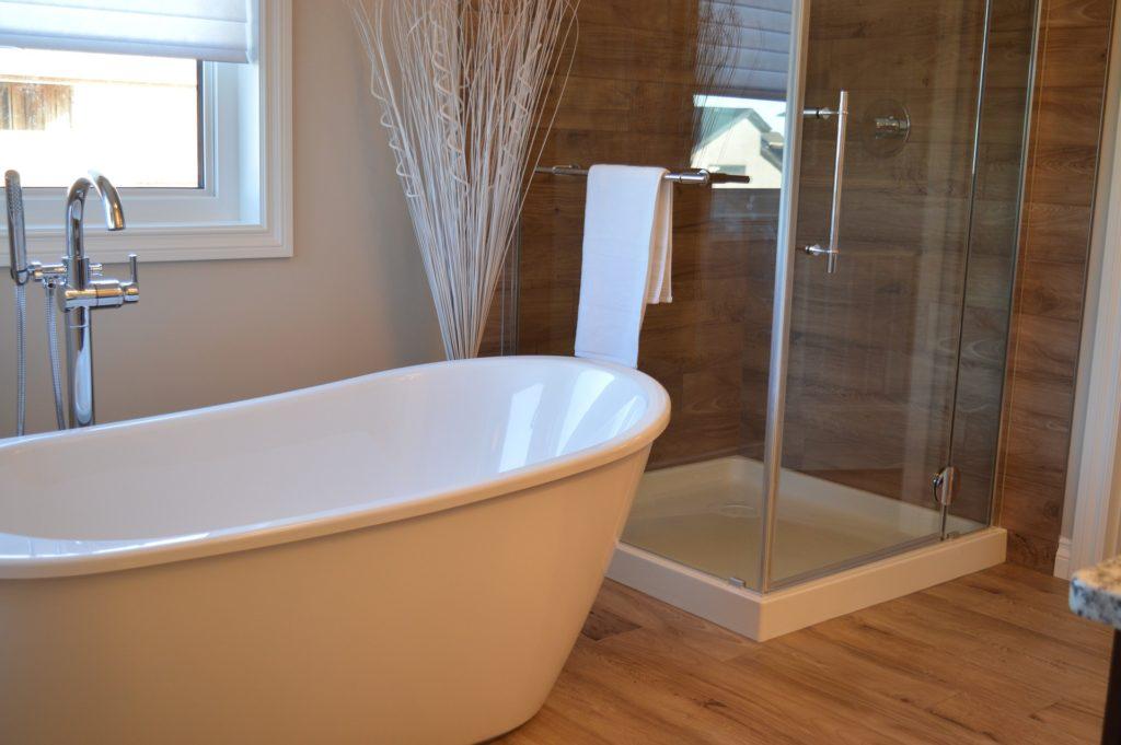 bathtub and shower inside bathroom