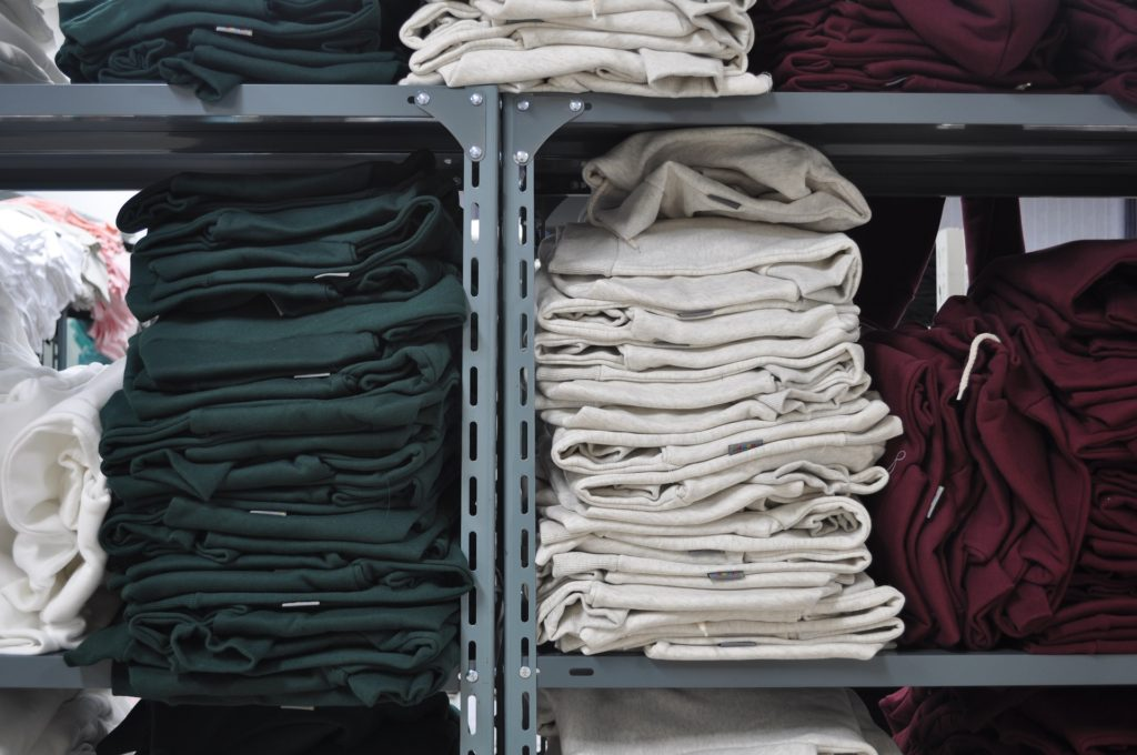 Different colors of clothes in a closet