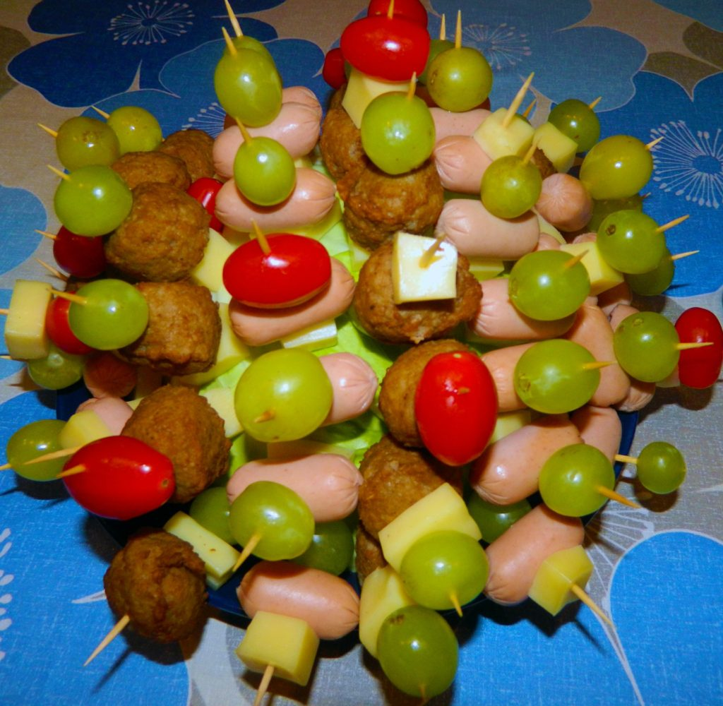Sticks filled with different food types.