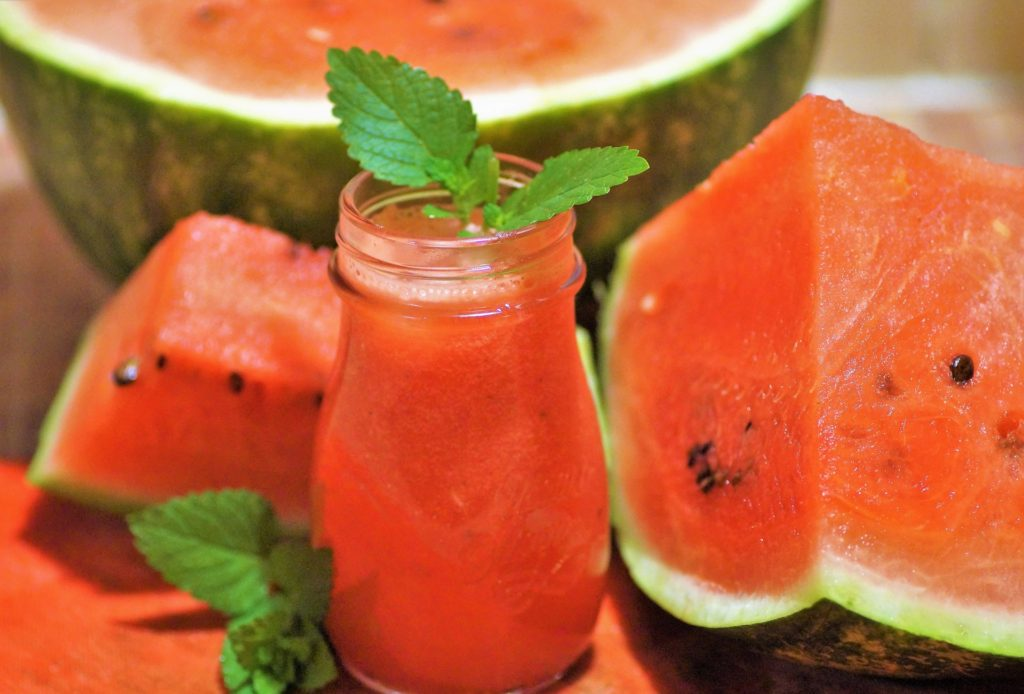 Watermelon lemonade with a leaf in a glass.